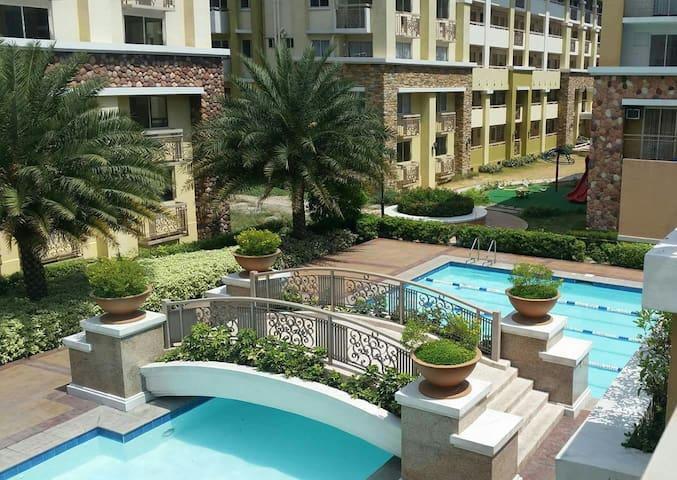 Furnished 2BR w/ garden area near Ortigas