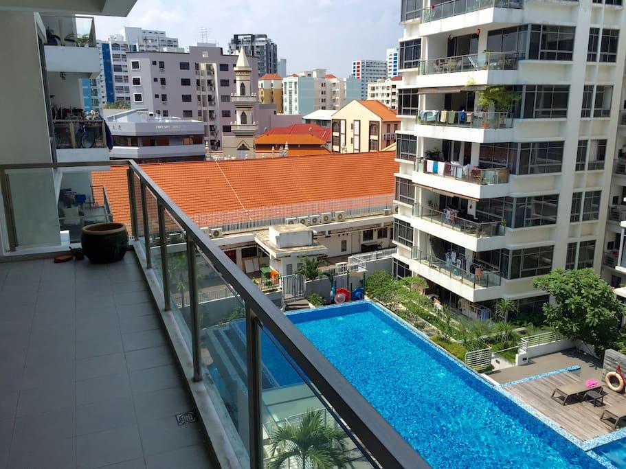Balcony overlooking swimming pool