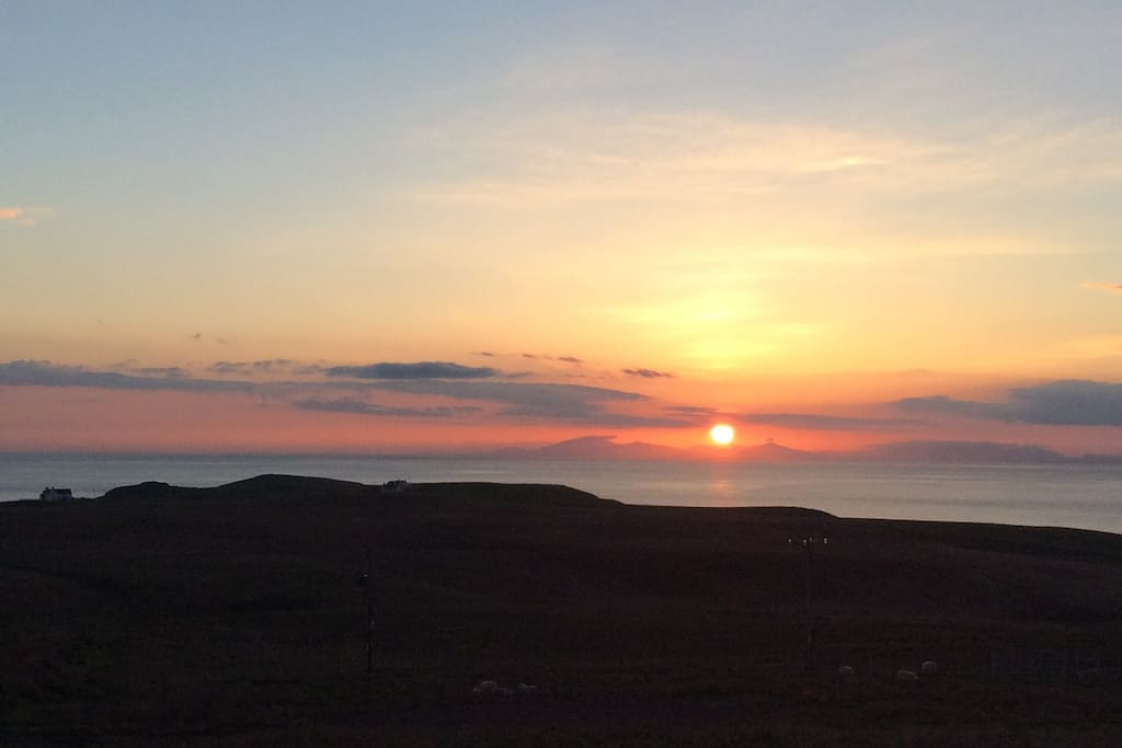 View from the cottage - sunset over  Western Isles