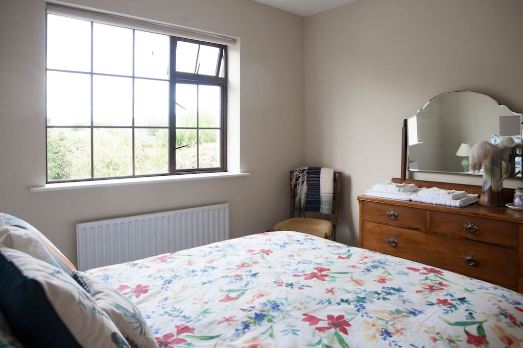 Elegant and peaceful double bedroom looking out at Sliabh Bán