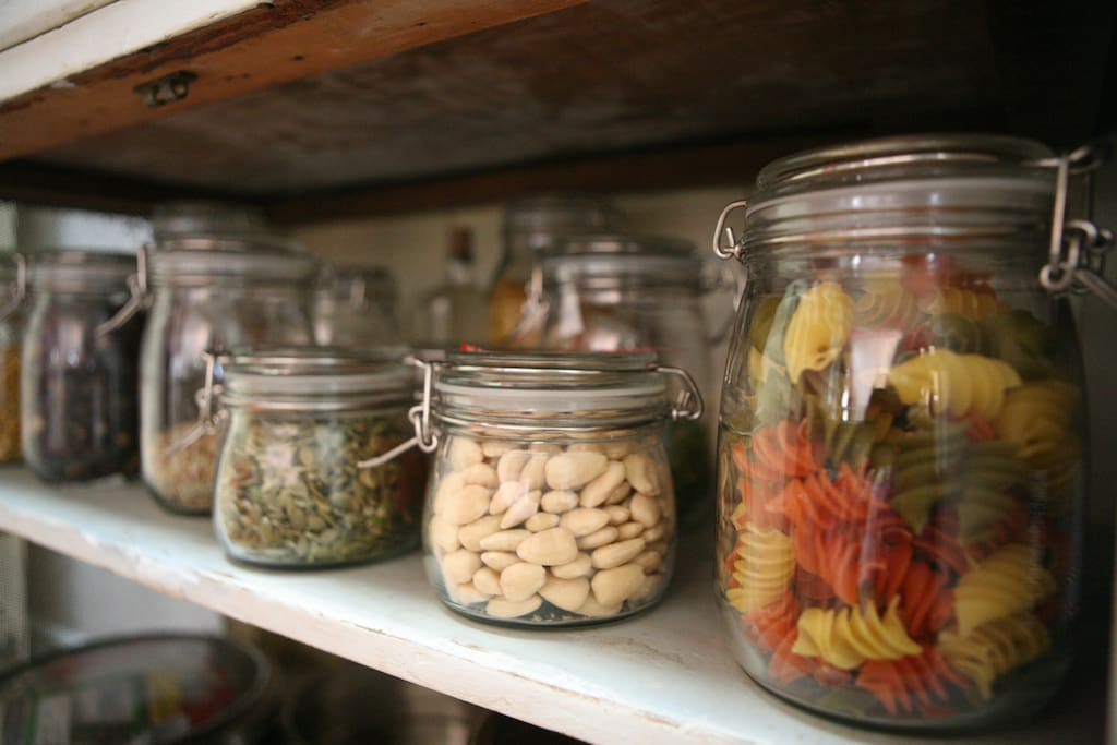 All the little touches are a throw back to  days of old... sealed toped glass storage jars...