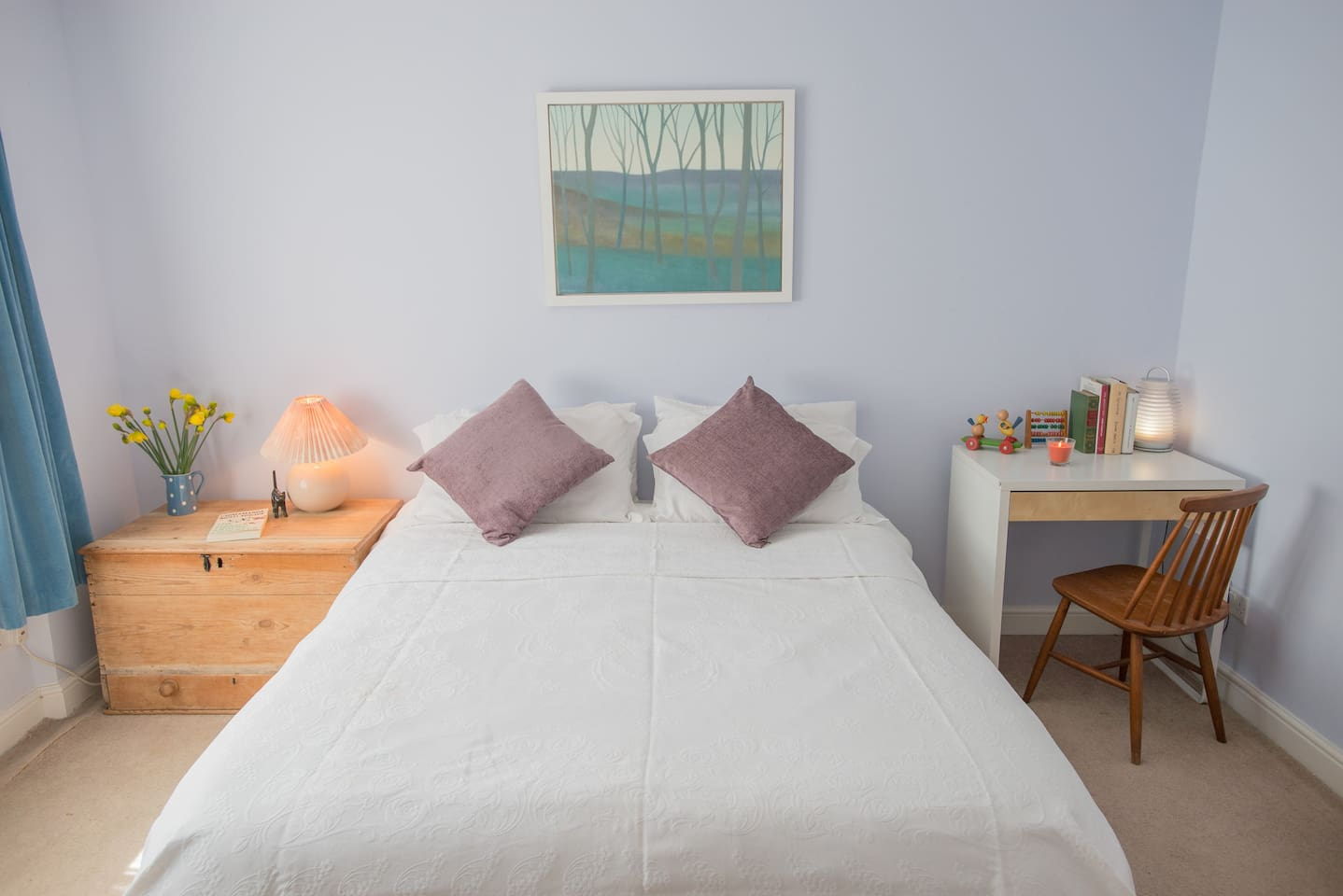 Comfortable quiet bedroom with queen size bed and reading lamps.