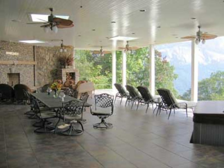 2000 sq ft pavilion with complete kitchen, hot tub, fireplace, 2 separate dining area, wall mounted TV.