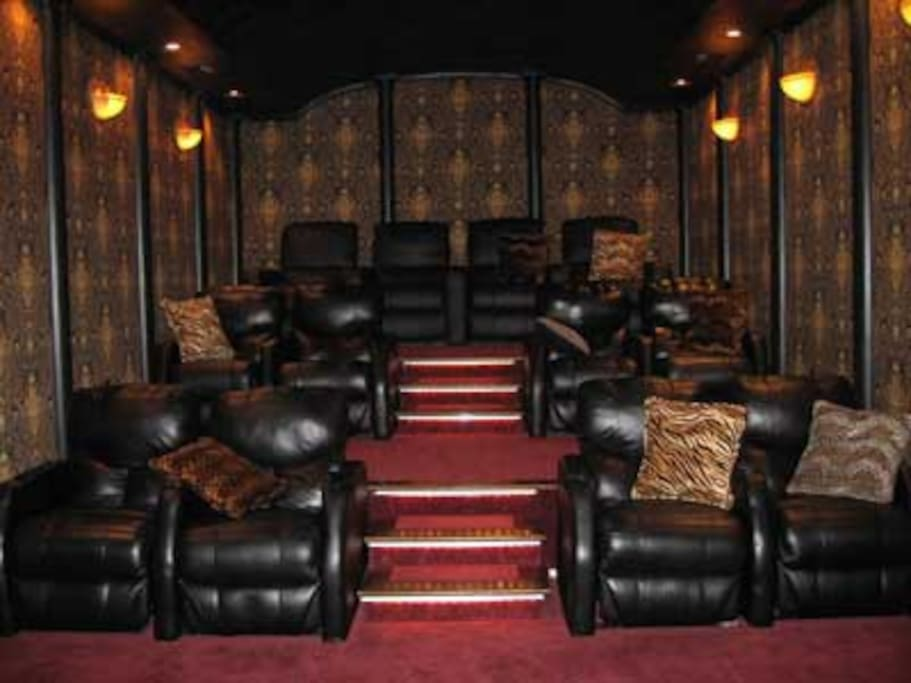 13 seat theatre with surround sound and over 300 DVD's equipped with pillows and throws