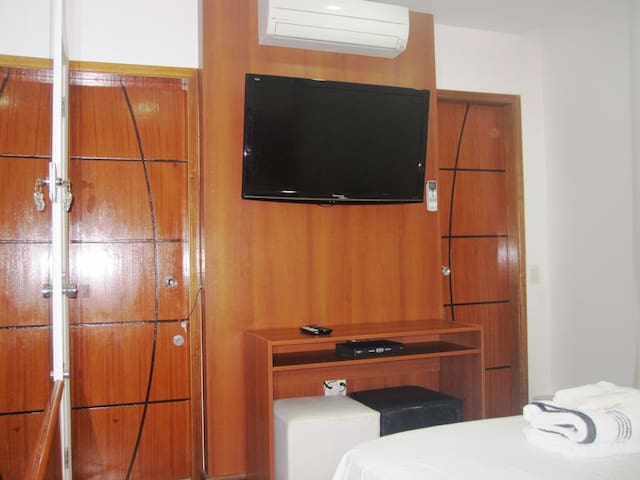 """42 """" TV with cable channels in English and Portuguese. Silent Split Air Conditioning unit."""