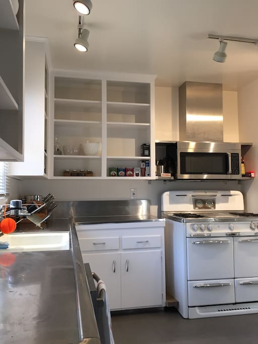 Vintage 1950's stainless steel kitchen updated with new microwave and dishwasher, ceramic tile floors, LED track lighting, Keurig coffee maker