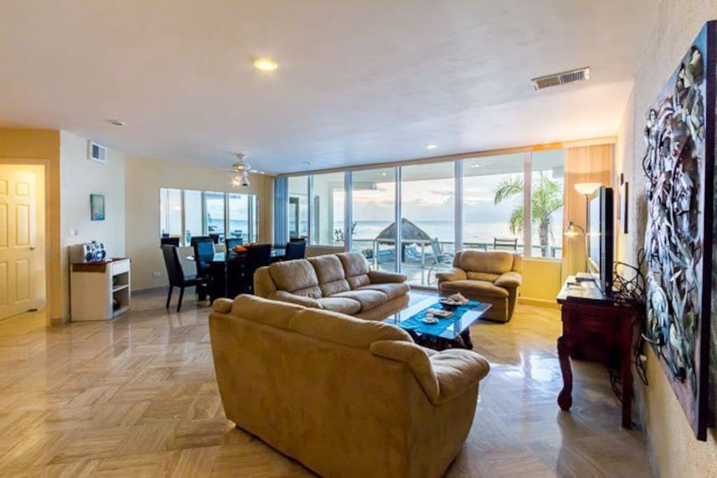 The fantastically appointed living room offers stunning views of the ocean
