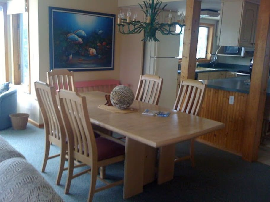 Dining room with extra chairs to invite guests over for dinner... sits 8-10