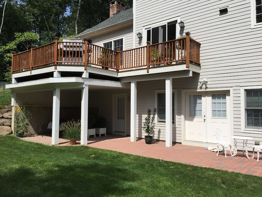 Another view of the back of the house and guest area on the lower level. Private entrance left of the double doors
