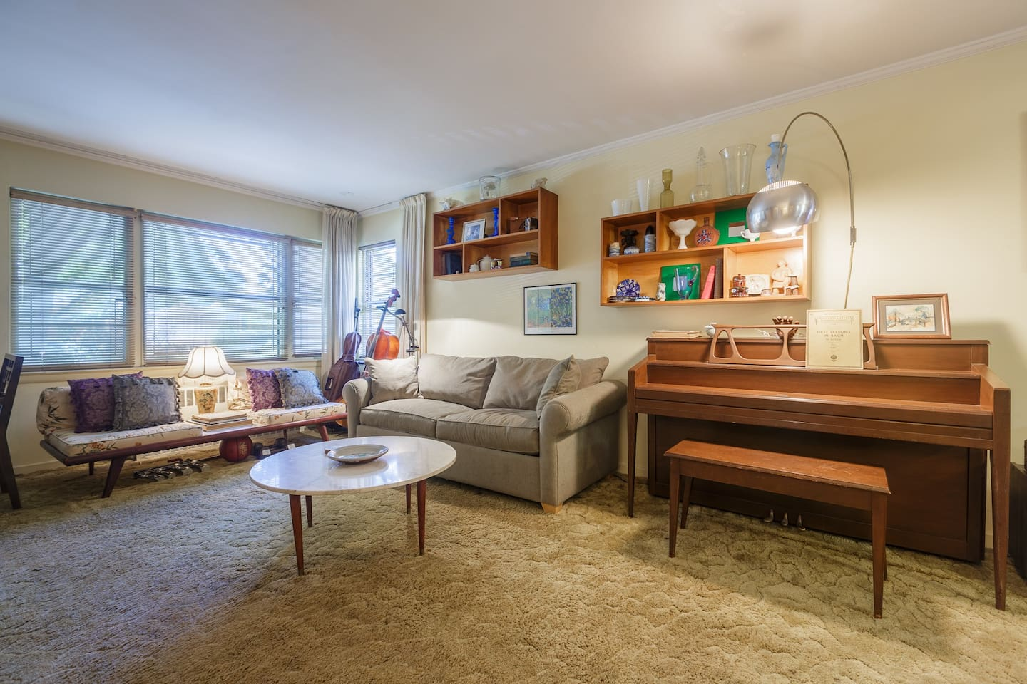Our living room has plenty of seating, a piano and a pullout couch with a queen mattress.