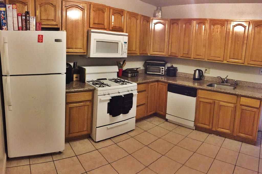 Full Kitchen, Wooden Cabinets, New Appliances (Dishwasher, Stove, Microwave and Oven), Open Refrigerator
