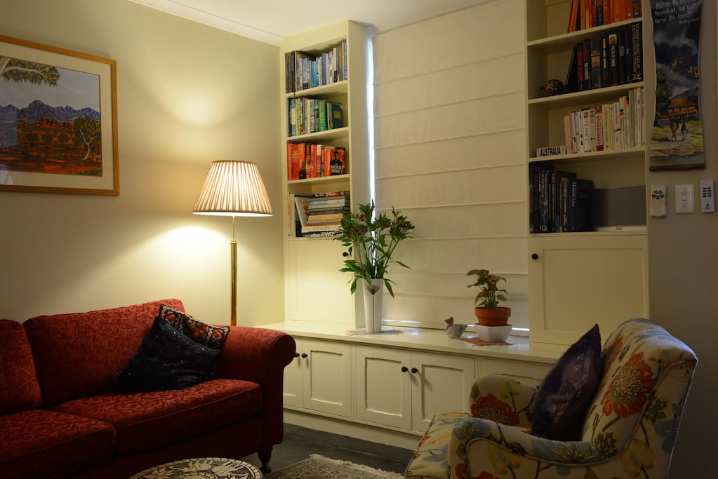 Peace and quiet in the shared living room.  Sit and read while watching people walk past through the window