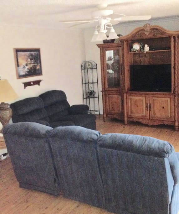2 reclining sofas and flat screen tv