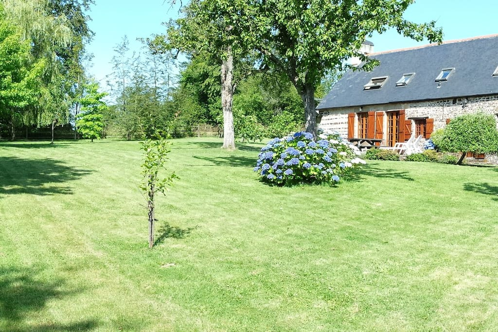 Large mature garden surrounding the house