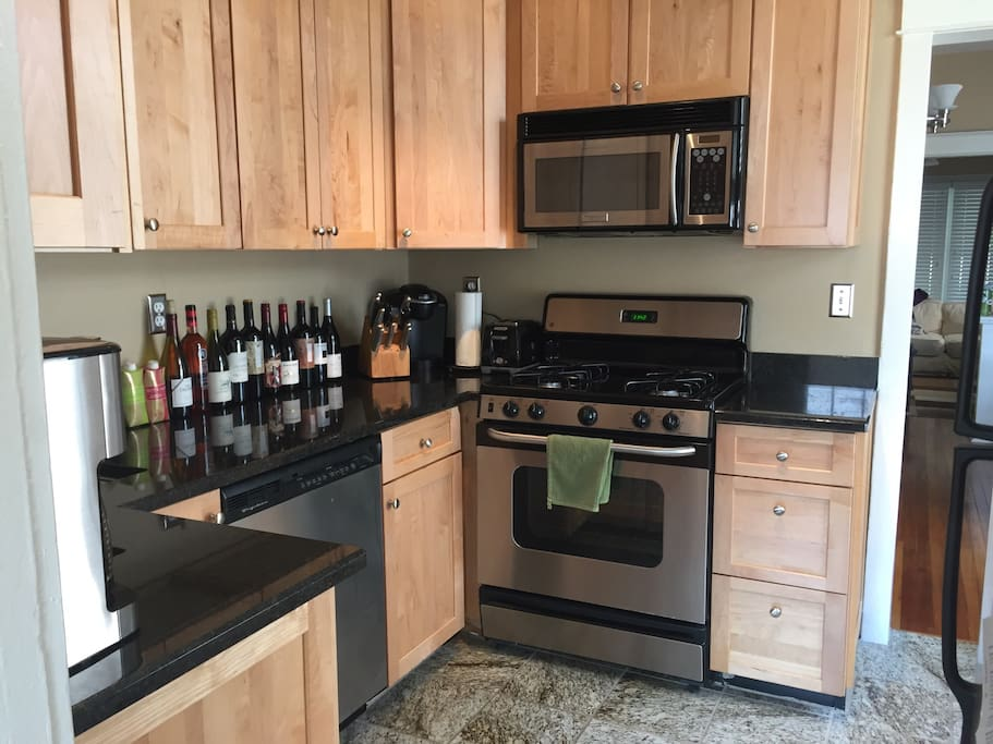 Remodeled kitchen with new appliances and great coffee maker.