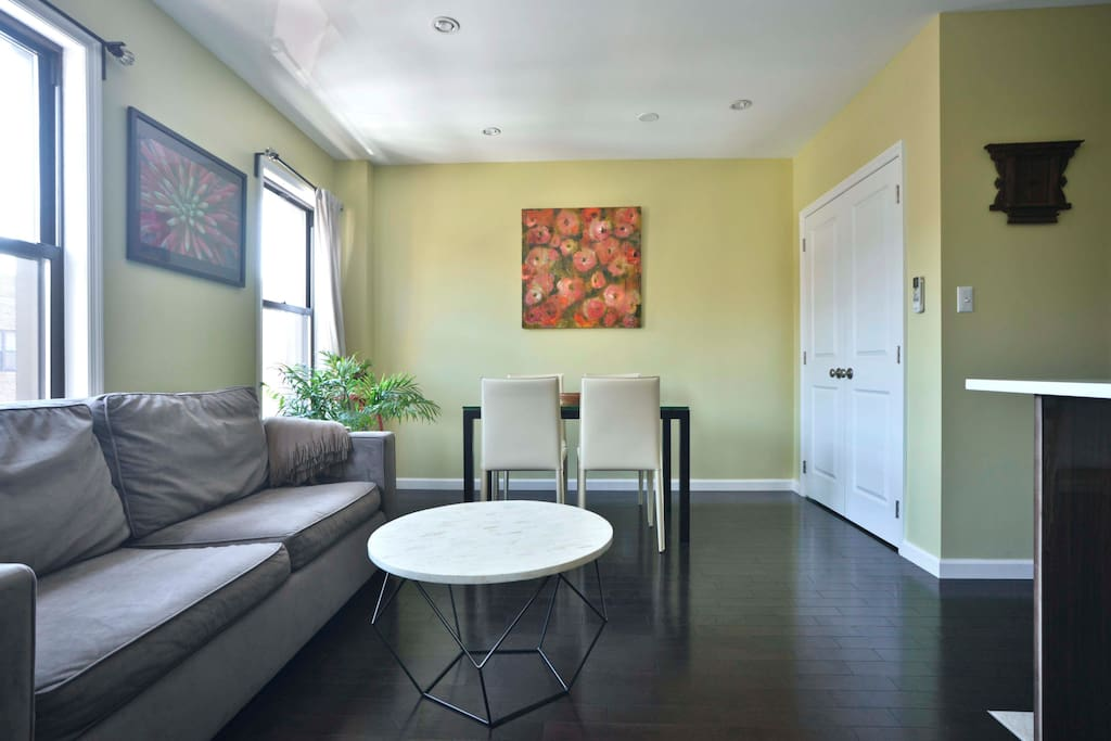 Bright, spacious living room with lots of seating