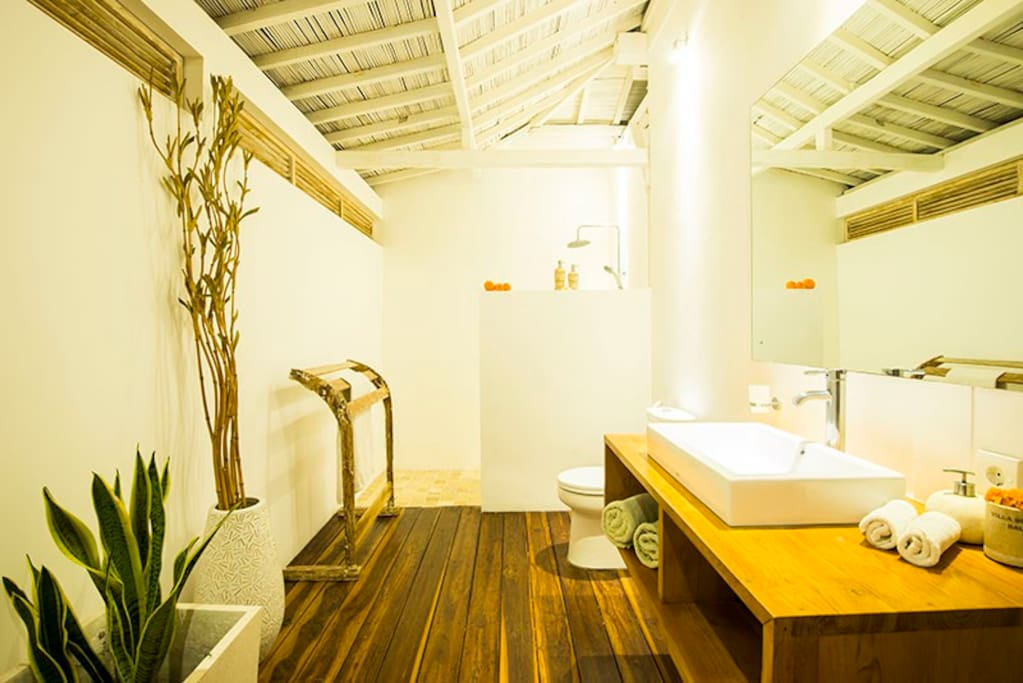 Bathroom with wooden deck and teak cabinet