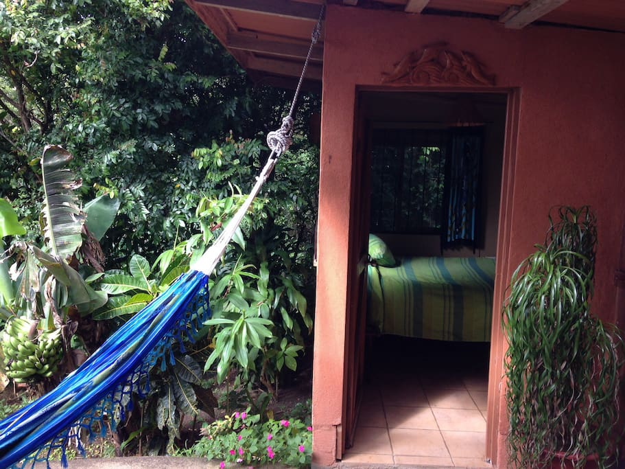 Bedroom opens to this patio sitting area , monkeys and bird viewing  here, Wind surf, Kite, jungle hikes, hot springs, waterfall hikes, Arenal Volcano gift shops.