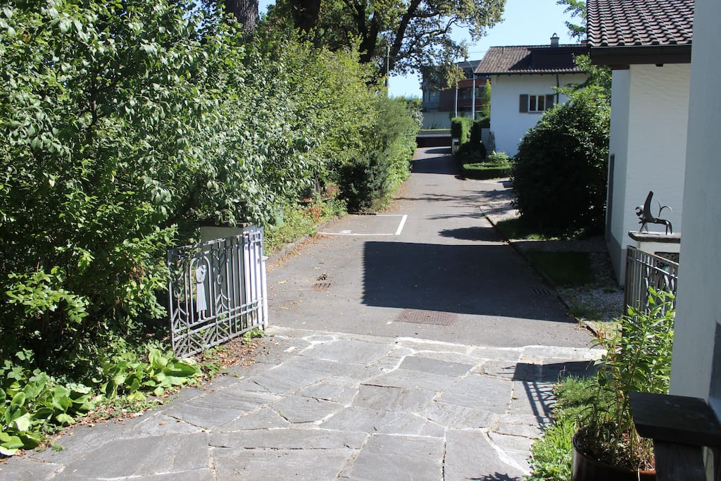 parking on the road (white marked left hand side from the house)