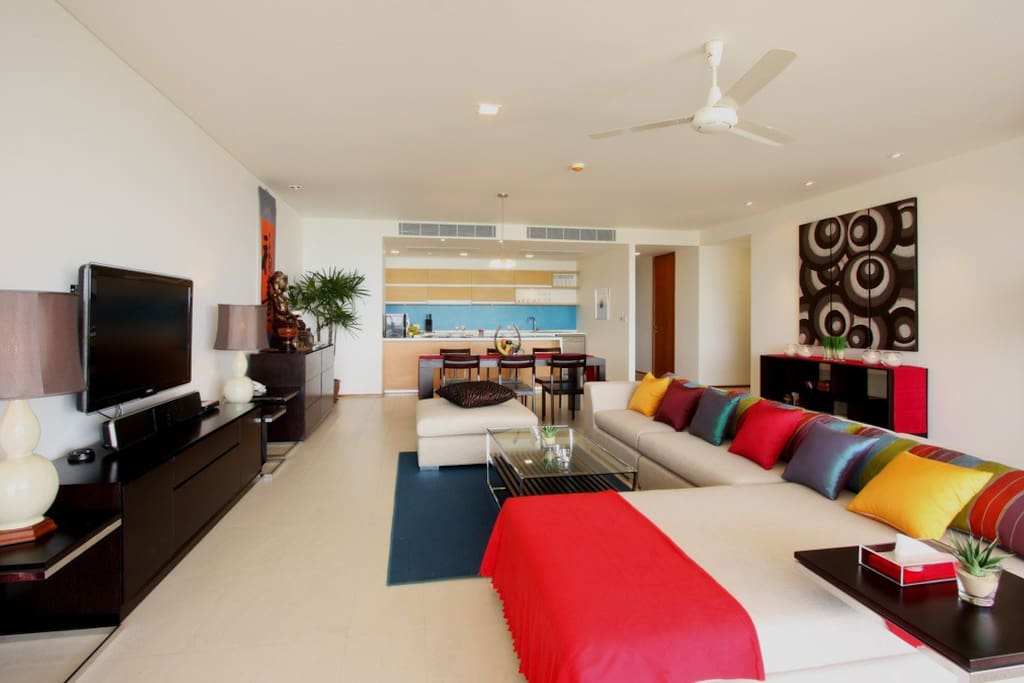 Open plan living/dining room decorated in Thai contemporary style