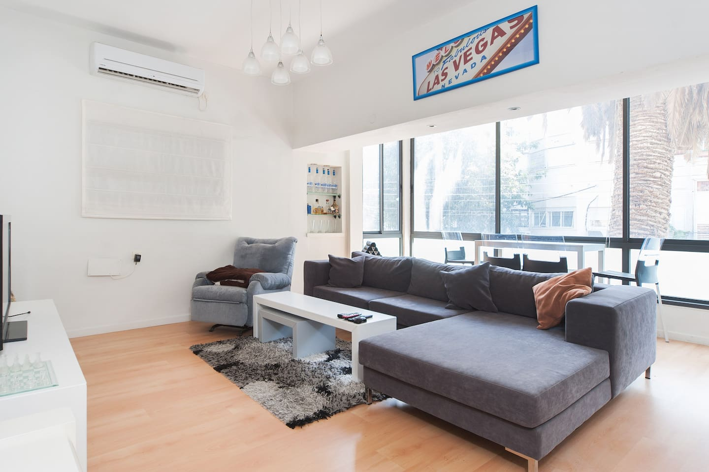 Spacious air conditioned living room with lots of natural light entering from the glass fronted window viewing the peaceful street