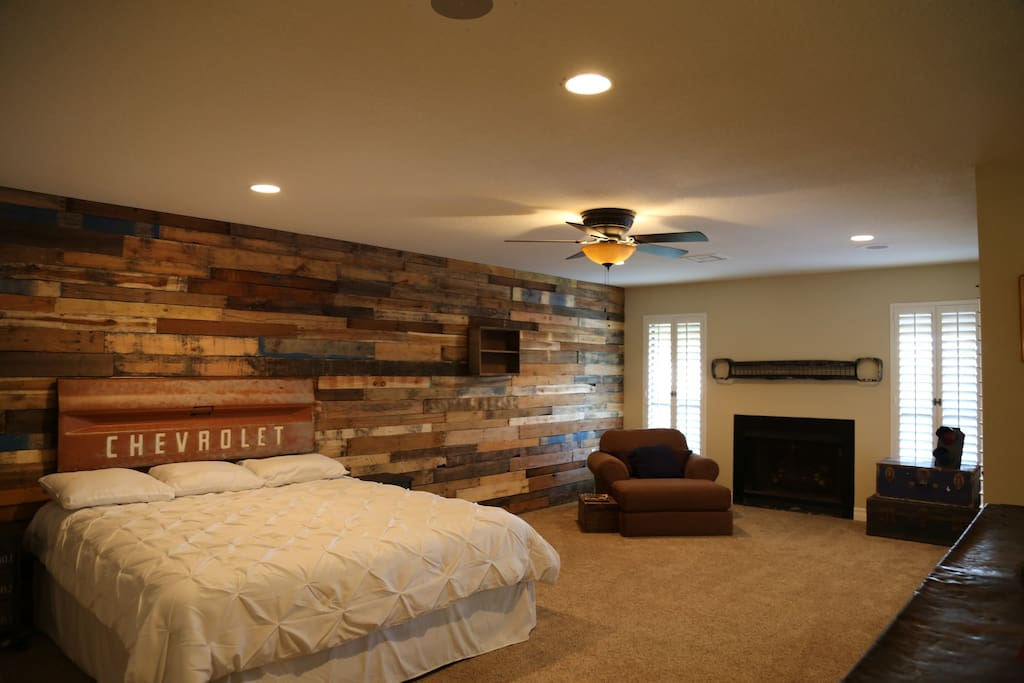 Master Bedroom with a King sized bed and a fire place.