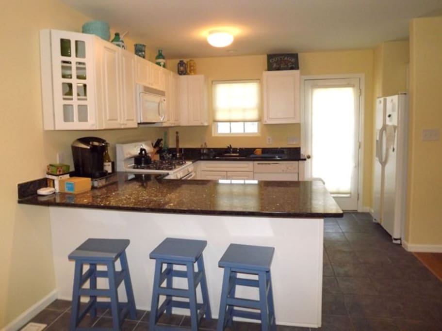 Kitchen with fully supplied K-Cups and coffee maker. Microwave, toaster, stove and oven.