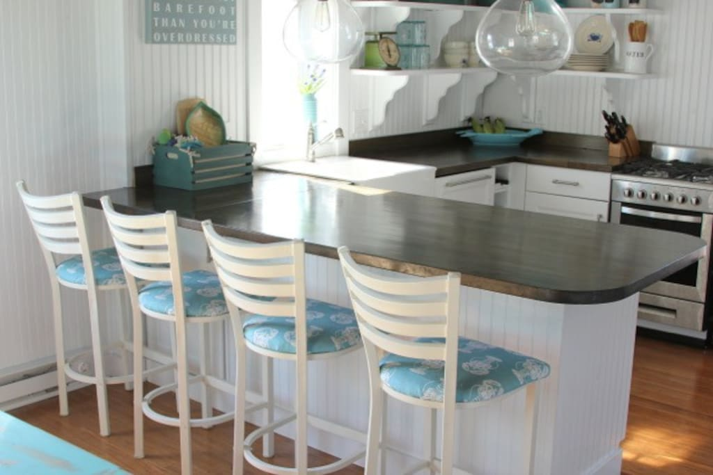 Kitchen with barstools and open shelving.