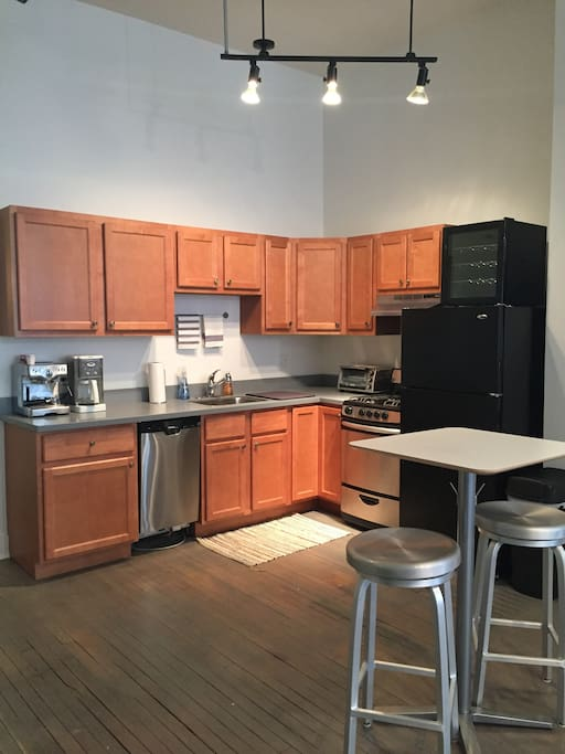 Large kitchen with ample cabinet space, dishwasher and garbage disposal.