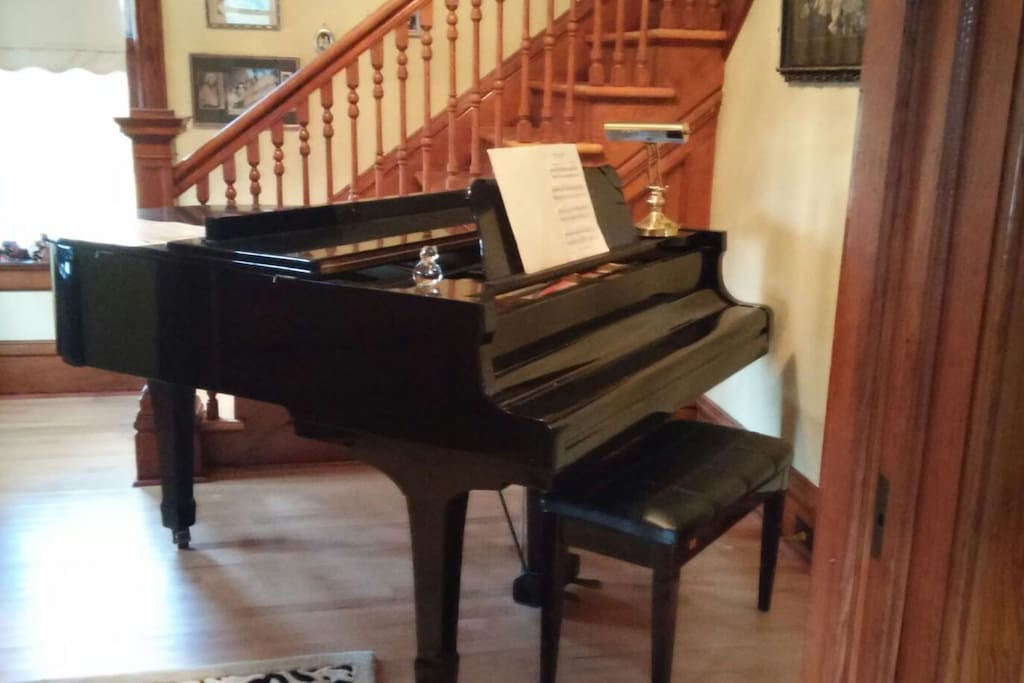 Baby Grand piano in the foyer