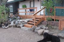 """Front deck & pond with our dog """"Rogue"""""""