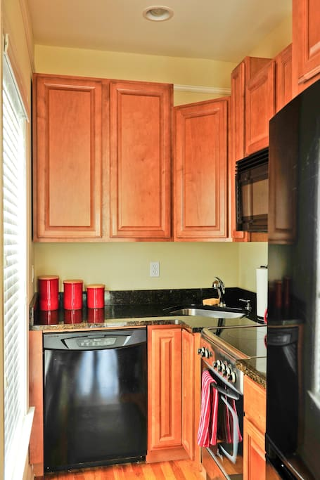 Full Kitchen with Stove, Microwave, dishwasher and Refrigerator