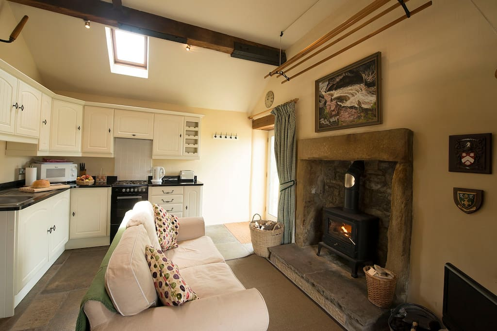 Cosy Sitting Room with wood-burning stove.