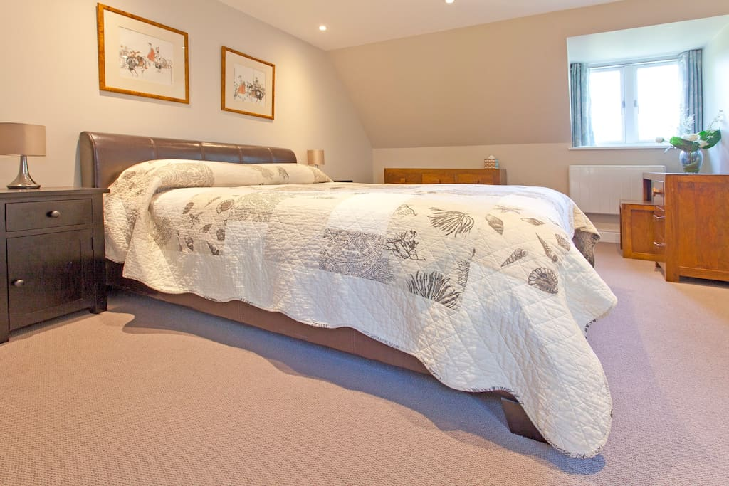 Luxury king size bed with views to the gardens