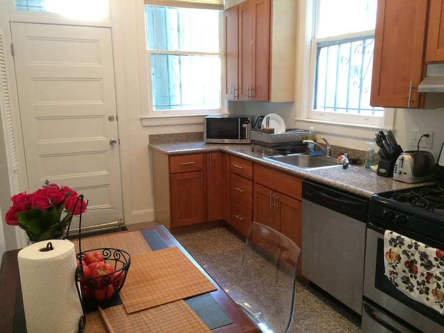 Clean, modern, very large kitchen with built in dishwasher / and all modern appliances