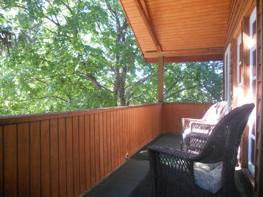 Deck in the trees off of the bedroom