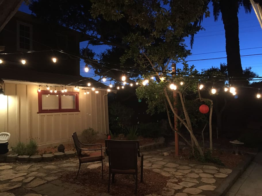Courtyard is lit with Italian lights for a relaxing and special ambiance between the two areas
