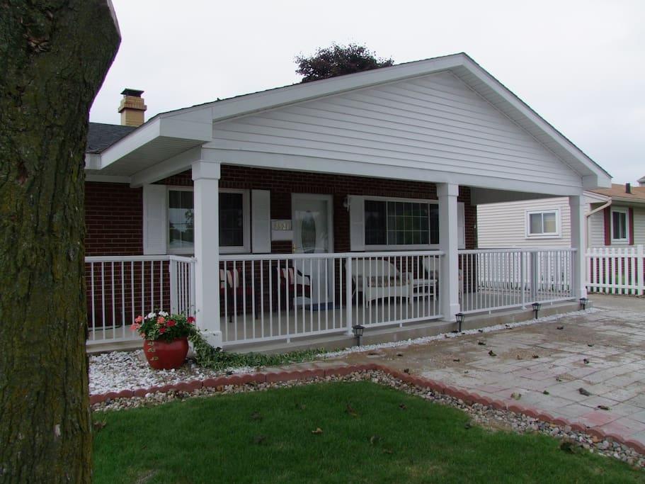 Fenced enclosed front porch.