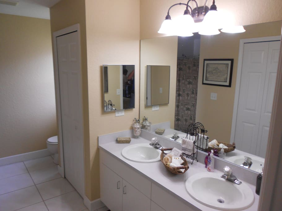 The master bath has dual sinks and a walk in shower.