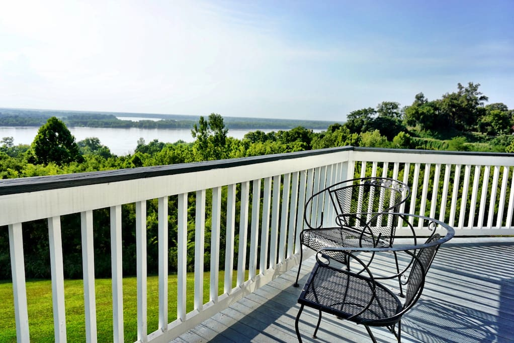 Our 2nd-floor veranda has a panoramic view of the Mississippi River -- all the way from the Vidalia Bridge -- to Huck Finn's wilderness to the north.