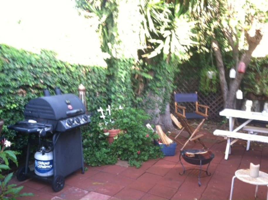 Gas BBQ in private backyard