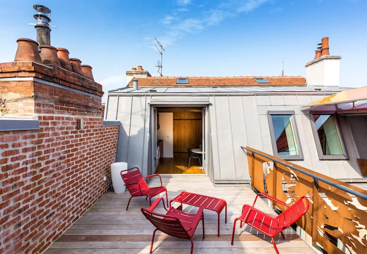 55m2 avec terrasse en ville, vue sur les toits