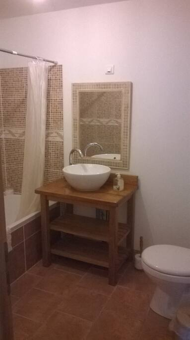 Family room Ensuite bathroom with bath, overhead shower, sink, toilet and heated towel rail.