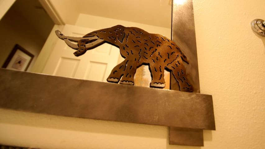 Luxurious Modern Mountain Style Throughout.  Woolly mammoth mirror detail.