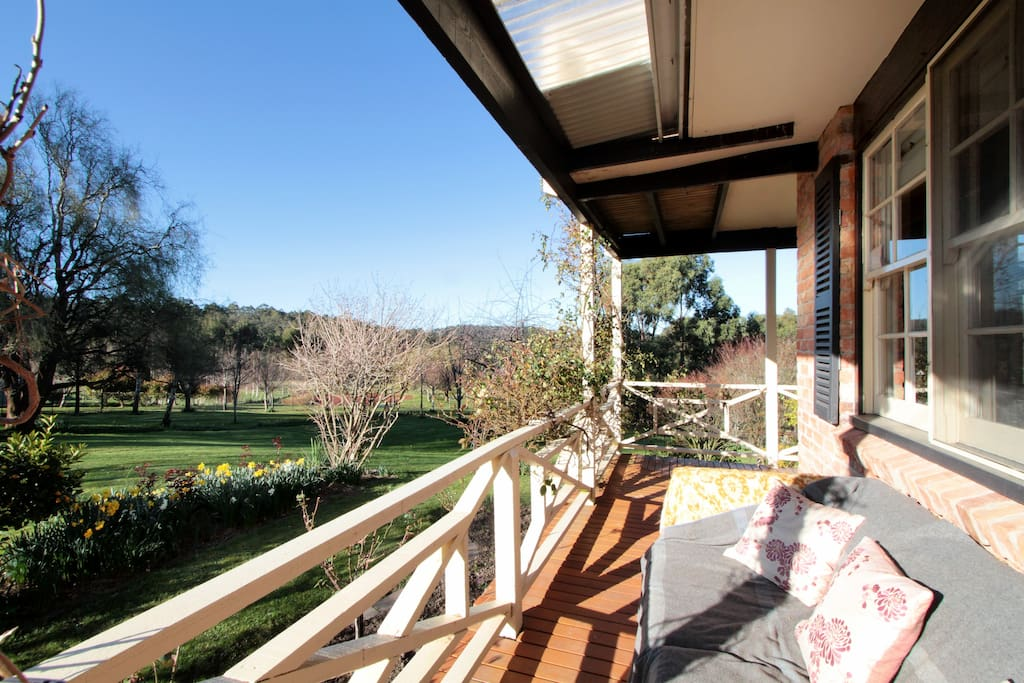 Sun drenched veranda with 2 comfy couches and chairs