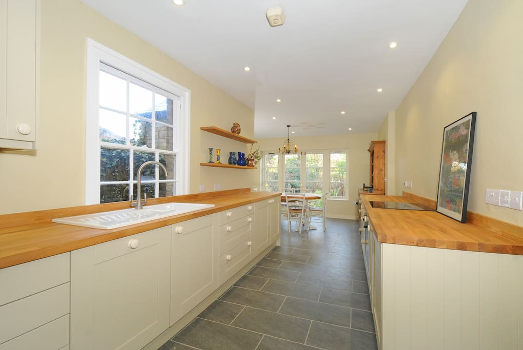 lovely  kitchen/ dining room with doors to garden