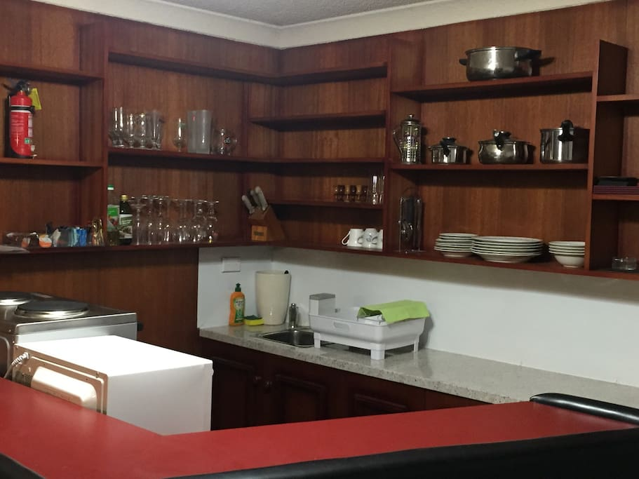 Newly installed Kitchenette with stove, microwave and complete cooking utensils
