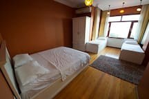 Interiors featuring ocean view, 1 king size, 2 single beds