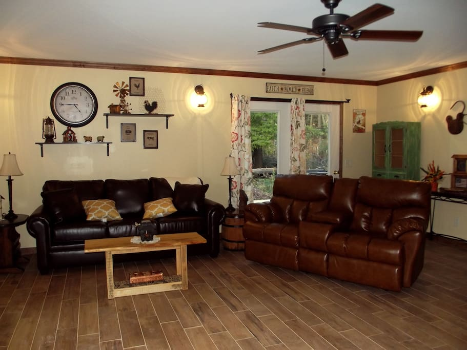 living room with 2 leather couches