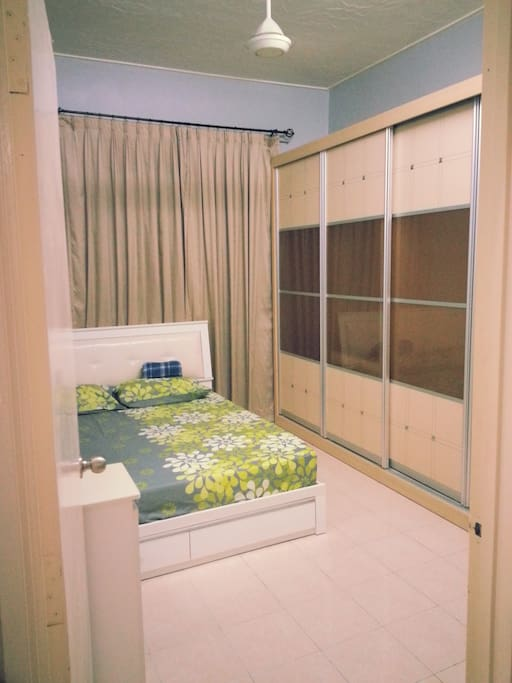 This is 1st Room or Master Bedroom. It attached with a bathroom which come with water heater. The room is equipped with air-conditioner.